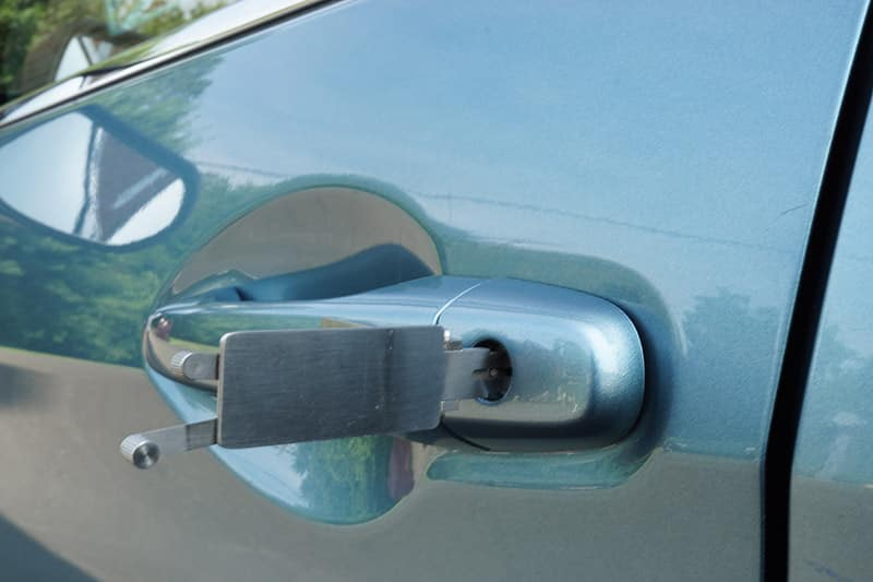 Image of a door handle lock in the process of being picked by a professional locksmith