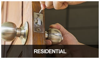 Image of a locksmith replacing a residential door lock