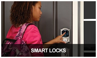 Image of a girl using an electronic keypad smart lock on a residential front door
